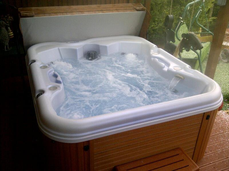Teak hot tub ready for action